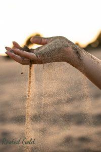 extraordinary hand in sand shot