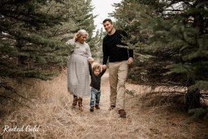 Family walking through with Pine trees